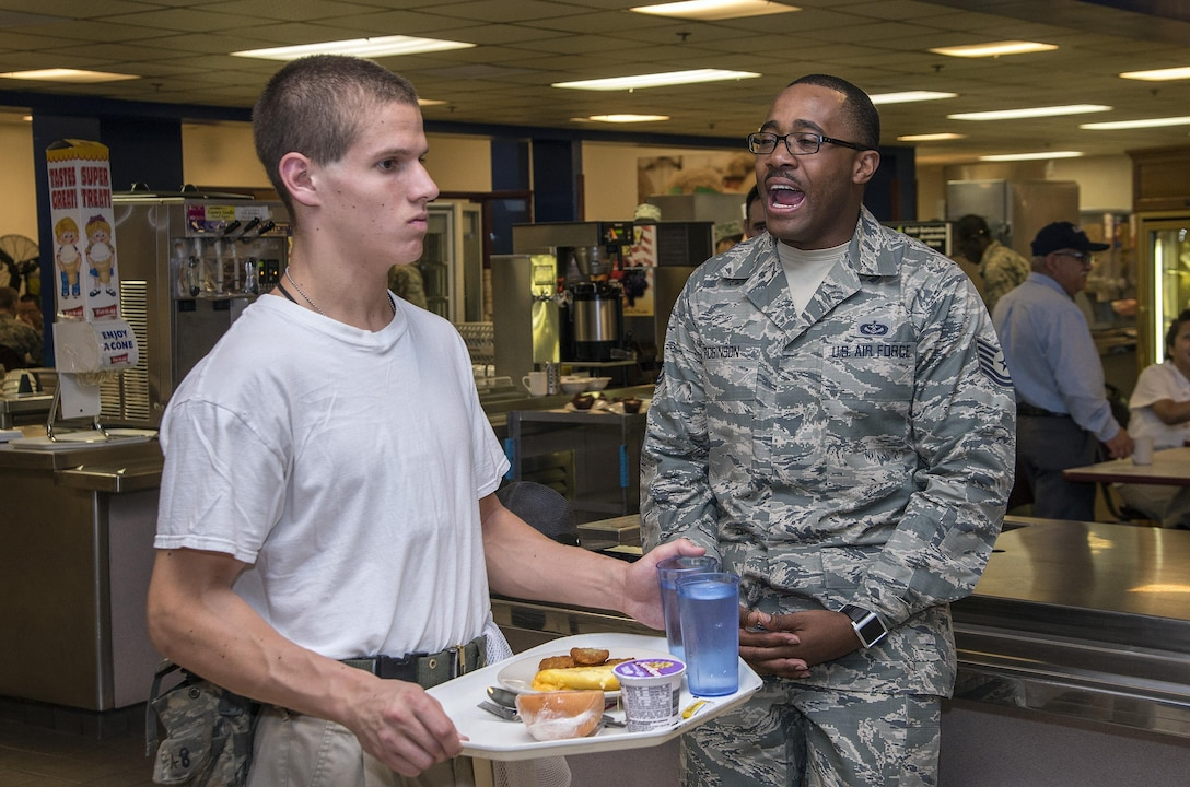 Tech. Sgt. Edroy Robinson, 331st Training Squadron military training instructor, provides instructions to newly arrived Air Force basic trainees May 20, 2015, at Joint Base San Antonio-Lackland's 331st TRS dormitory dining facility. Military training instructors are vital to maintaining the world's greatest Air Force. In 7 ½ weeks, MTIs transform America's sons and daughters from civilians into Airmen by instilling discipline, attention to detail, esprit de corps and challenging them physically and mentally. (U.S. Air Force photo by Johnny Saldivar)