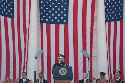 Chairman of the Joint Chiefs of Staff Gen. Martin E. Dempsey gives the welcome address for the National Memorial day observance, on Memorial Day, Monday, May 25, 2015, at Arlington National Cemetery in Arlington, Va.