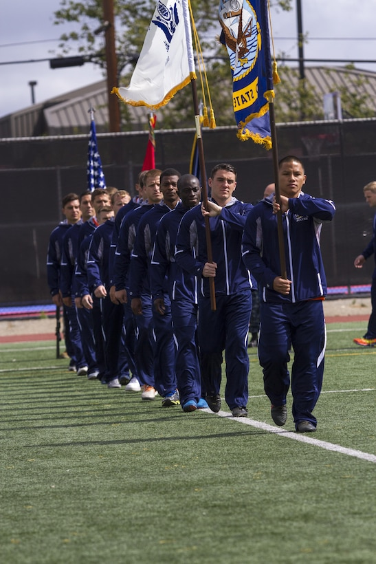 Members of the combined U.S. Navy and U.S. Coast Guard soccer team march onto the field during the opening ceremony of the 2015 Armed Forces Soccer Championship May 14 at Marine Corps Air Station Miramar, Calif. Service members from each branch came to Miramar to compete in the championship.