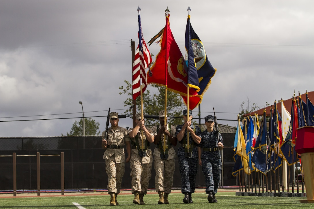 A combined Marine, Sailor color guard marches onto the field May 14 during the opening ceremony of the 2015 Armed Forces Soccer Championship at Marine Corps Air Station Miramar, Calif. Service members from each branch will compete in the championship games.