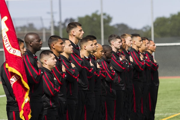 Marines with the All-Marine soccer team place their hands over their hearts while the National Anthem plays during the opening ceremony of the 2015 Armed Forces Soccer Championship May 14 at Marine Corps Air Station Miramar, Calif. The week-long championship tournament will the the Marines against the other branches of the U.S. military.