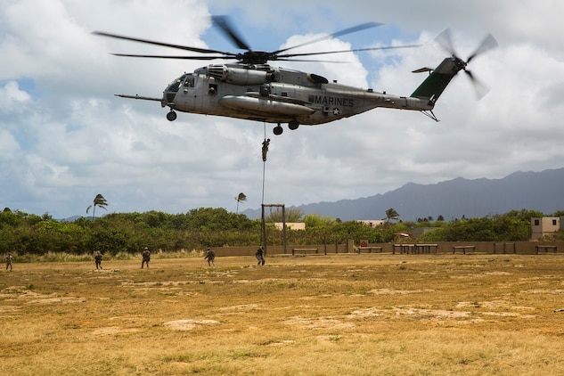 U.S. Marines with the 15th Marine Expeditionary Unit's Maritime Raid Force security element fast rope out of a CH-53E Super Stallion aboard Marine Corps Base Hawaii, May 12, 2015. Fast roping gives the MRF the ability to rapidly insert combat forces onto an objective. (U.S. Marine Corps photo by Cpl. Anna Albrecht/Released)