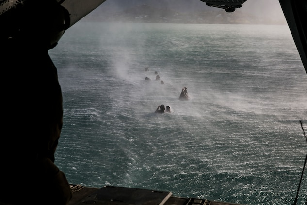 U.S. Marines with the 15th Marine Expeditionary Unit's Maritime Raid Force helocast out of a CH-53 Super Stallion aboard Marine Corps Base Hawaii, May 14, 2015. The MRF is building on their success during the 15th MEU's pre-deployment training program to ensure they are ready for a wide variety of missions. (U.S. Marine Corps photo by Cpl. Anna Albrecht/Released)