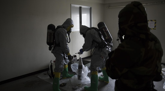 Marines contain a leaking ordnance round during leak, seal, package and decontamination training April 21 at the gas chamber on Camp Hansen, Okinawa. Explosive ordnance disposal technicians and chemical, biological, radiological, nuclear defense specialists placed a leaking ordnance package in the gas chamber, using chlorobenzylidene malonitrile, also known as tear gas, to simulate the emission of harmful gases.  The EOD technicians and CBRN defense specialists used protective equipment to safely contain the leaking ordnance and prepare the package for transport out of the affected area before completing the decontamination process. The training instilled the Marines' confidence in the safety equipment and procedures used to mitigate CBRN-related hazards. The Marines are with 9th Engineer Support Battalion and Marine Logistics Group Headquarters Regiment, 3rd MLG, III Marine Expeditionary Force.