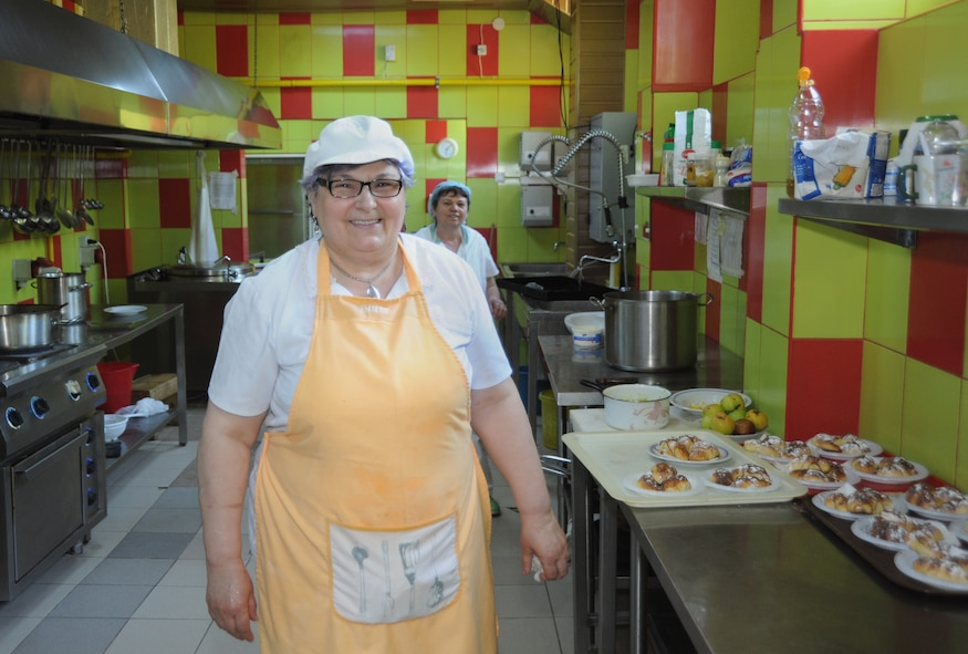 Katy Graur, a food service worker for the Mangalia City Hospital, Romania, poses for a portrait after cooking a traditional Romanian meal for members of the 142nd Fighter Wing Civil Engineer Squadron, Oregon Air National Guard in Mangalia, Romania May 8, 2015. The group deployed to Romania to renovate a medical clinic here as part of U.S. European Command's (EUCOM) Humanitarian Civic Assistance Program (HCA). The EUCOM HCA program is designed to improve the host nation's critical infrastructure and the underlying living conditions of the civilian populace. (U.S. Air National Guard photo by Staff Sgt. Brandon Boyd 142nd Fighter Wing Public Affairs/Released)