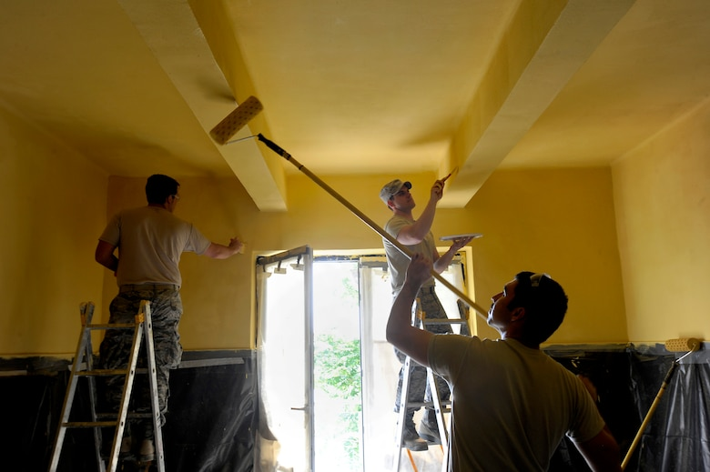 Oregon Air National Guard Airmen assigned to the 142nd Fighter Wing Civil engineer squadron work together to paint clinical treatment rooms at a medical facility in the city of Mangalia, Romania, May 18, 2015, as part of the U.S. European Command's (EUCOM) Humanitarian Civic Assistance Program (HCA). The EUCOM HCA program is designed to improve the host nation's critical infrastructure and the underlying living conditions of the civilian populace. (U.S. Air National Guard photo by Tech. Sgt. John Hughel, 142nd Fighter Wing Public Affairs/Released)