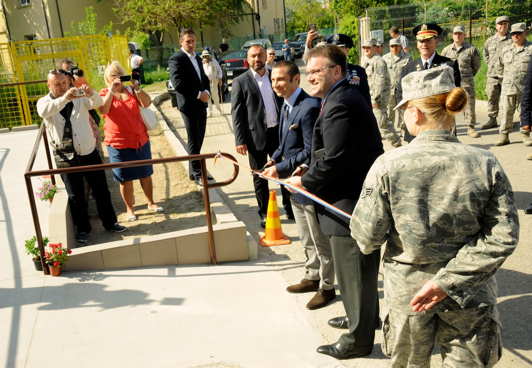 U.S. Charge d'Affairs a.i., Dean Thompson, along with with Mayor of Mangalia, Romania, Radu Cristian, cut the ribbon to the renovated Pavilion C of the Mangalia City Hospital, Romania, May 20, 2015, as part of the U.S. European Command's (EUCOM) Humanitarian Civic Assistance Program (HCA). The EUCOM HCA program is designed to improve the host nation's critical infrastructure and the underlying living conditions of the civilian populace. (U.S. Air National Guard photo by Tech. Sgt. John Hughel, 142nd Fighter Wing Public Affairs/Released)