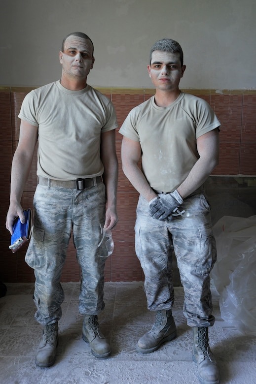 Oregon Air National Guardsmen Senior Airmen Daniel Hagemier, left, and Dustin Sevilla, right, both assigned to the 142nd Fighter Wing Civil Engineer Sqauadron, pause briefly for a photograph together after sanding plaster in a clinic treatment room at a medical being repaired in the city of Mangalia, Romania, May 13, 2015, as part of the U.S. European Command's (EUCOM) Humanitarian Civic Assistance Program (HCA). The EUCOM HCA program is designed to improve the host nation's critical infrastructure and the underlying living conditions of the civilian populace. (U.S. Air National Guard photo by Tech. Sgt. John Hughel, 142nd Fighter Wing Public Affairs/Released)