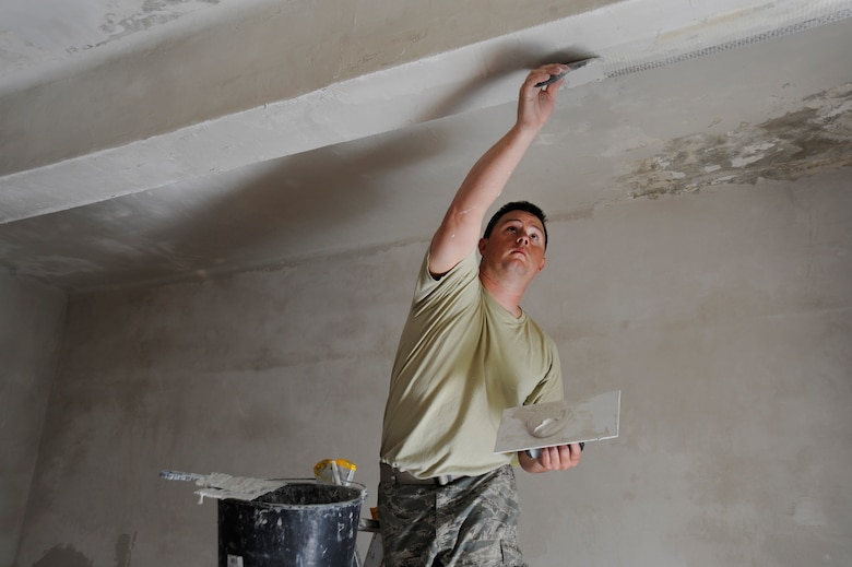 Oregon Air National Guard Tech. Sgt. Charles Jedda, assigned to the 142nd Fighter Wing Civil Engineer Squadron applies plaster to upgrade and repair water damage to a local health clinic in the city of Mangalia, Romania, May 11, 2015, as part of the U.S. European Command's (EUCOM) Humanitarian Civic Assistance Program (HCA). The EUCOM HCA program is designed to improve the host nation's critical infrastructure and the underlying living conditions of the civilian populace. (U.S. Air National Guard photo by Tech. Sgt. John Hughel, 142nd Fighter Wing Public Affairs/Released)