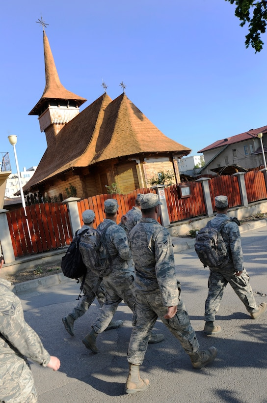 Airmen from the Oregon Air National Guard's 142nd Fighter Wing Civil Engineer Squadron enjoy the local architecture during a morning commute to the construction site at a local health clinic in the city of Mangalia, Romania, May 12, 2015, as part of the U.S. European Command's (EUCOM) Humanitarian Civic Assistance Program (HCA). The EUCOM HCA program is designed to improve the host nation's critical infrastructure and the underlying living conditions of the civilian populace. (U.S. Air National Guard photo by Tech Sgt. John Hughel, 142nd Fighter Wing Public Affairs/Released)