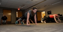 Senior Airman Morissa Martin, 28th Medical Operations Squadron aerospace medical technician, performs core-strengthening exercises during a personal workout routine at Ellsworth Air Force Base, S.D., May 19, 2015. Martin also participates in yoga and cycling each week to improve her physical fitness. (U.S. Air Force photo by Airman 1st Class Rebecca Imwalle/Released)