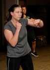 Senior Airman Morissa Martin, 28th Medical Operations Squadron aerospace medical technician, shadow boxes during her workout at Ellsworth Air Force Base, S.D., May 19, 2015. Each week, Martin participates in a high-intensity exercise program with her coworkers to achieve fitness goals. (U.S. Air Force photo by Airman 1st Class Rebecca Imwalle/Released)