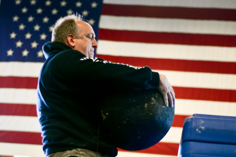 U.S. Air Force Lt. Col. Don Braskett trains with a concrete sphere April 28, 2015, at Rickenbacker Air National Guard Base, Ohio. (U.S. Air National Guard photo by Master Sgt. Ralph Branson/Released)