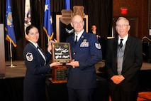 U.S. Air Force Master Sgt. Vanessa Johnston, 55th Intelligence Support Squadron and 55th Wing Association Board of Directors member along with U.S. Air Force Col. (Ret.) Hamilton Kennedy Awards Chair for the 55th Wing Association, presents U.S. Air Force Tech. Sgt. William Nelsen, 55th Maintenance Squadron, with the 55th Wing Association Award for Excellence at the 2015 55th Wing Birthday Ball held at the Embassy Suites in LaVista, Nebraska, May 16. The 55th Wing Award for Excellence is presented to an individual in the 55th Wing who best exemplifies the basic tenets of the 55th Wing Association. (U.S. Air Force photo by Jeff W. Gates/Released)