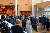 Patrons arrive inside the Embassy Suites in La Vista, Nebraska for the 2015 55th Wing Birthday Ball, May 16. The birthday ball is a formal celebration recognizing the wing's proud heritage as well as its current mission and role in the U.S. Air Force. (U.S. Air Force photo by Jeff W. Gates/Released)