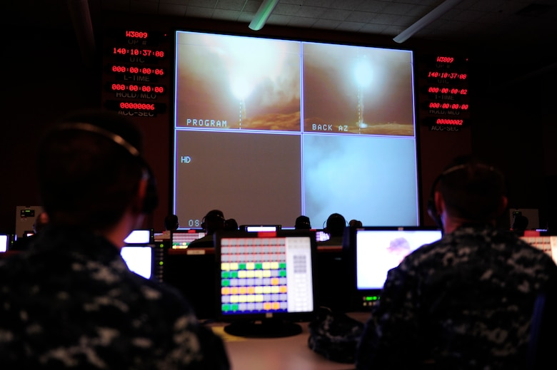 Launch team members and visitors watch as an unarmed Minuteman III intercontinental ballistic missile launches from Vandenberg Air Force Base, California, at 3:37 a.m. Pacific Daylight Time, May 20, 2015. The ICBM was randomly pulled from a silo on F.E. Warren, transported and reassembled at Vandenberg, and launched by crew members from the 625th Strategic Operations Squadron, aboard a U.S. Strategic Command E-6B Airborne Command Post aircraft. Every test launch verifies the accuracy and reliability of the ICBM weapon system, providing valuable data to ensure a safe, secure and effective deterrent for as long as nuclear weapons exist. (U.S. Air Force photo by Staff Sgt. Jim Araos/Released)