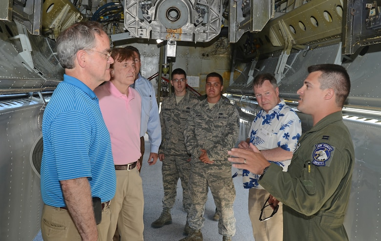 Capt. Alexander Barwikowski (right), B-52 Stratofortress weapons system officer with the 20th Expeditionary Bomb Squadron, guides representatives with the House Armed Services Committee during a tour of the aircraft's bomb bay, May 24, 2015, at Andersen Air Force Base, Guam. Congress members visited the bases to gain a better understanding of current rebalance efforts in the Pacific region. (U.S. Air Force photo by Senior Airman Alexander W. Riedel/Released)