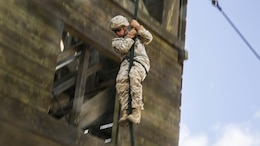 U.S. Marine Lance Cpl. Zane Harmon fast ropes from a tower aboard Marine Corps Base Hawaii, May 12, 2015. Harmon is part of the 15th Marine Expeditionary Unit's Maritime Raid Force security element. These Marines practice fast roping to ensure they are prepared for any type of mission during deployment. (U.S. Marine Corps photo by Cpl. Anna Albrecht/Released)