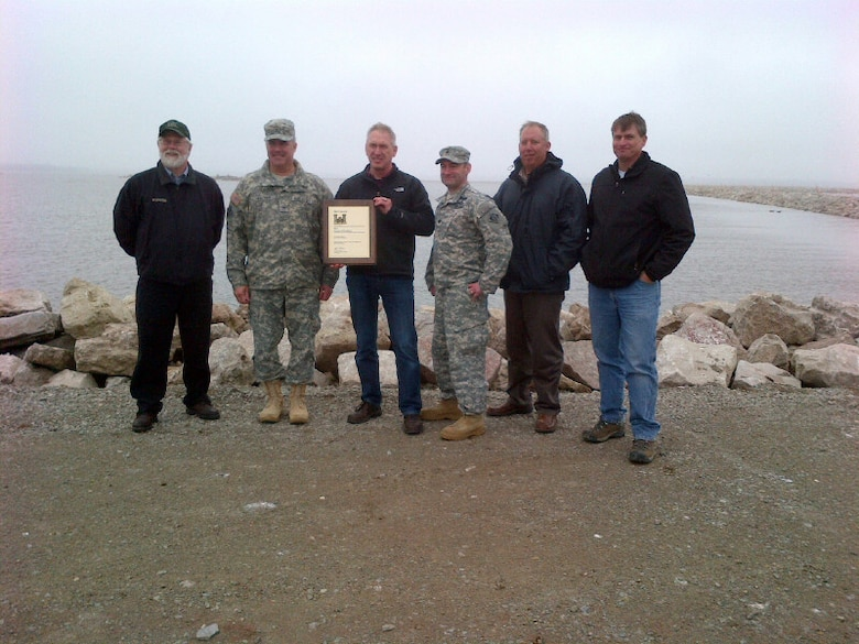 """Brig. Gen. Richard Kaiser presented the Cat Island Team the """"Environmental Merit Award"""" on behalf of the Chief of Engineers.  From left to right: Mark Walter, Brown County, business manager; Brig. Gen. Richard G. Kaiser, USACE Great Lakes and Ohio Rivers Division Commander; Duane Talbot, Corps Kewaunee Sub Office construction representative, holding award; Lt. Col. Mike Sellers, USACE Detroit District Commander; Dean Haen, Brown County Port & Solid Waste Dept., port manager; Dan Wiesner, Corps Kewaunee sub office, chief Construction Branch."""