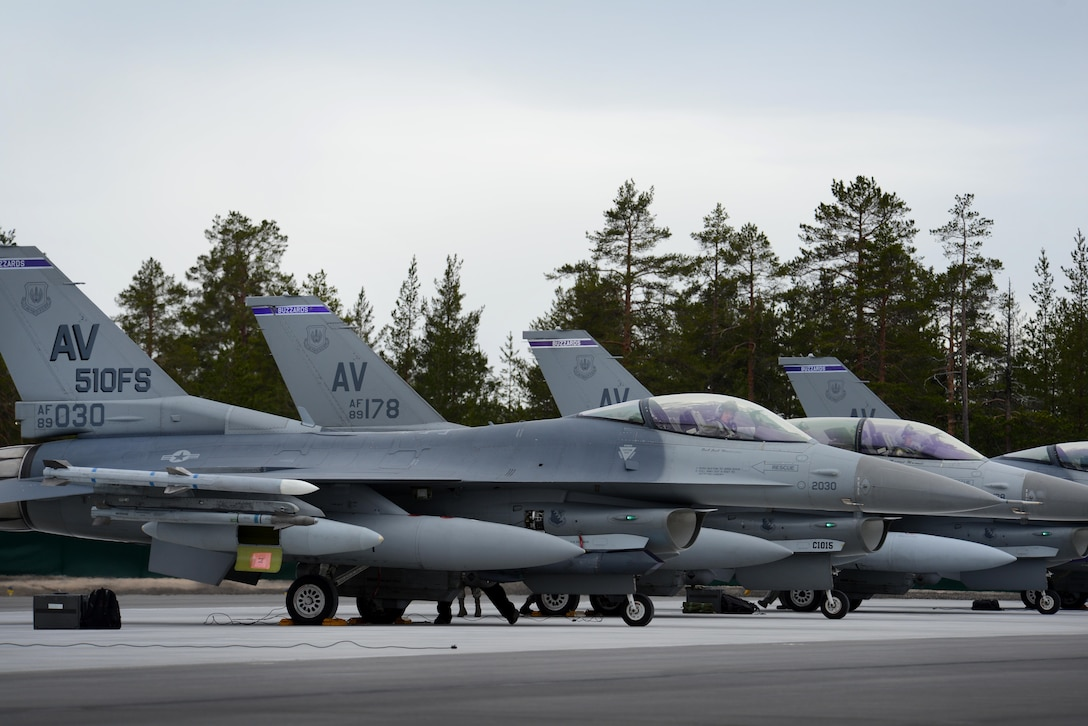 F-16 Fighting Falcons and Airmen from the 510th Fighter Squadron at Aviano Air Base, Italy, arrived at Kallax Air Base, Sweden, May 22, 2015, for Arctic Challenge Exercise 2015. Nine nations participated during the exercise to help ensure interoperability, and strengthen relationships and engagements with NATO allies and Partners for Peace. (U.S. Air Force photo/Staff Sgt. Evelyn Chavez)