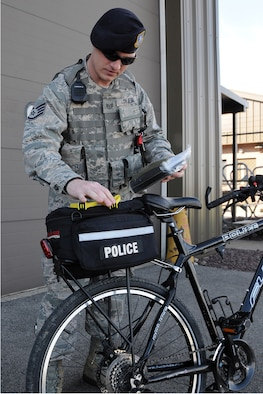 Air Force Reserve Staff Sgt. Adam Tyjeski, a security response team member assigned to the 910th Security Forces Squadron, shows the features of his patrol bike here, May 2, 2015. Tyjeski is among several squadron members qualified to perform this specialized duty as bike patrolmen and has been part of the patrol for two years. (U.S. Air Force photo/Tech. Sgt. James Brock)