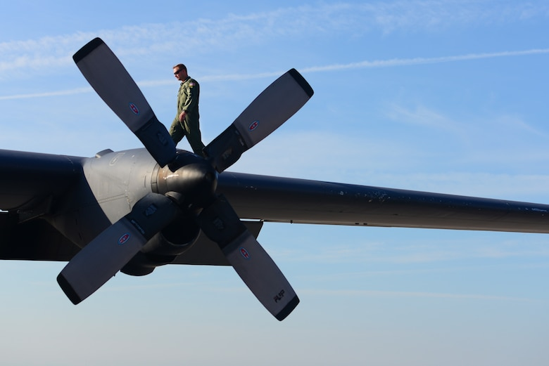 "A 16th Special Operations Squadron member walks on the wing of the AC-130H Spectre gunship, nicknamed ""Excalibur"", during a pre-flight inspection, May 27, 2015 at Cannon Air Force Base, N.M. Over the last two years, Air Commandos within the 16th Special Operations Squadron have bid farewell to the entire fleet of this historic aerial asset, as each of the eight aircraft have been one-by-one ceremoniously retired after 46 years of dedicated service. (U.S. Air Force photo/Senior Airman Eboni Reece)"