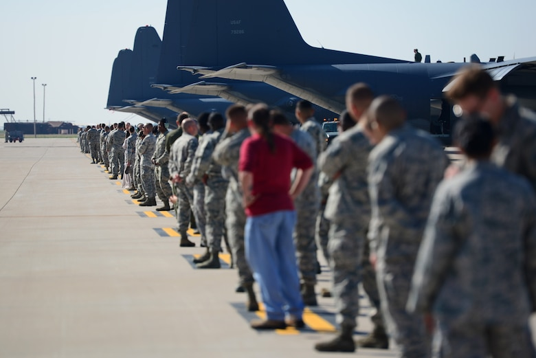 "Hundreds of Air Commandos lined up down the flightline to witness the final take-off of the AC-130H Spectre gunship, nicknamed ""Excalibur"", May 27, 2015 at Cannon Air Force Base, N.M. Over the last two years, Air Commandos within the 16th Special Operations Squadron have bid farewell to the entire fleet of this historic aerial asset, as each of the eight aircraft have been one-by-one ceremoniously retired after 46 years of dedicated service. (U.S. Air Force photo/Senior Airman Eboni Reece)"