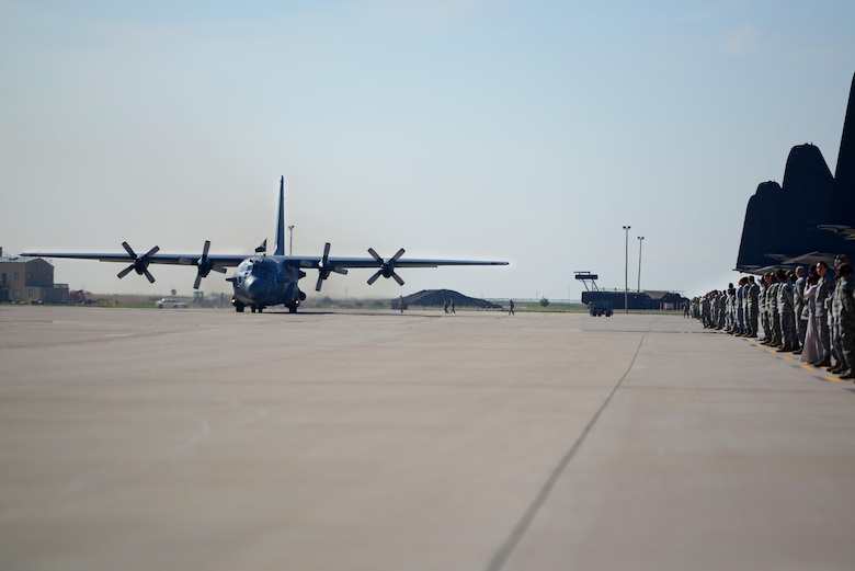 "Spectators watch as AC-130H Spectre gunship, nicknamed ""Excalibur"", taxis down the flightline for its final time, May 27, 2015 at Cannon Air Force Base, N.M. Over the last two years, Air Commandos within the 16th Special Operations Squadron have bid farewell to the entire fleet of this historic aerial asset, as each of the eight aircraft have been one-by-one ceremoniously retired after 46 years of dedicated service. (U.S. Air Force photo/Senior Airman Eboni Reece)"