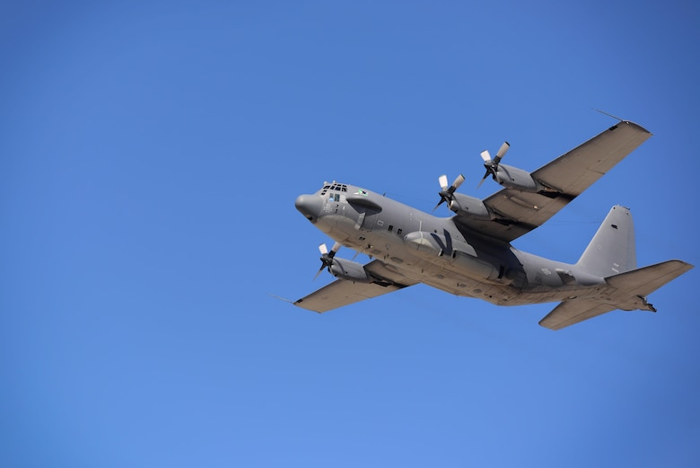 "An AC-130H gunship, nicknamed ""Excalibur"", flies overhead, May 26, 2015 at Cannon Air Force Base, N.M. The gunship has a long and proud history beginning in Southeast Asia over 46 years ago. (U.S. Air Force photo/Senior Airman Eboni Reece)"
