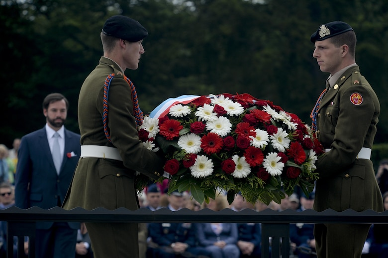 Crown Prince Guillaume of Luxembourg, left, waits to place a wreath carried by two Luxembourg army soldiers during a Memorial Day ceremony at the Luxembourg American Cemetery and Memorial May 23, 2015. More than 300 Luxembourgers and Americans gathered at the cemetery to reflect on the sacrifices made by fallen U.S. service members. (U.S. Air Force photo/Staff Sgt. Joe W. McFadden)