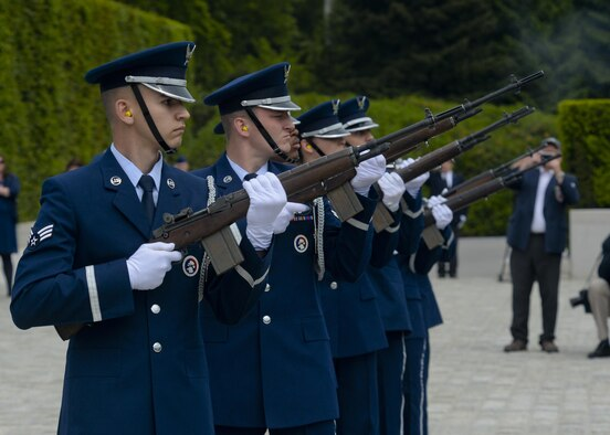 An honor guard detail executes a ceremonial volley during a Memorial Day ceremony at the Luxembourg American Cemetery and Memorial May 23, 2015. The base's Airmen also served as a ceremonial flight in service dress, caretakers of the cemetery's Luxembourg and U.S. flags, and escorts for guests to lay wreaths. (U.S. Air Force photo/Staff Sgt. Joe W. McFadden)