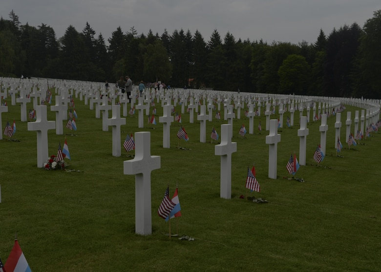 A row of memorial graves remain decorated with U.S. and Luxembourg flags after a Memorial Day ceremony at the Luxembourg American Cemetery and Memorial May 23, 2015. More than 300 Luxembourgers and Americans gathered at the cemetery to reflect on the sacrifices made by fallen U.S. service members. (U.S. Air Force photo/Staff Sgt. Joe W. McFadden)