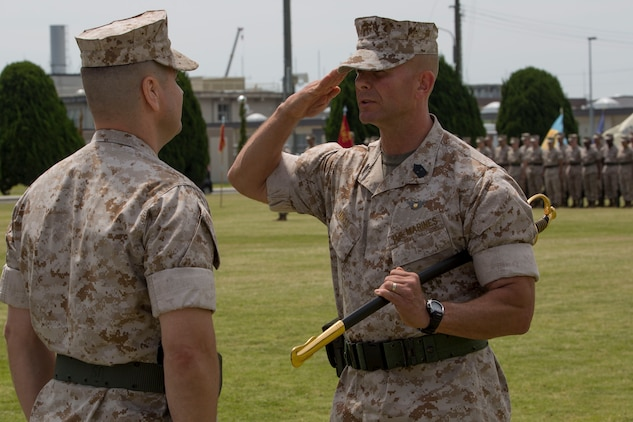 Sgt. Maj. Keith Massi relinquished control of his post as the Marine Corps Air Station Iwakuni, Japan, sergeant major during his relief ceremony May 22, 2015. Massi served as the station sergeant major from the summer of 2013 until the spring of 2015 and will now travel to Marine Corps Base Camp Pendleton, Calif., where he will serve as the 11th Marine Expeditionary Unit's new sergeant major.
