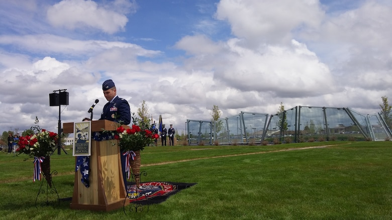 Col. John Wagner, 460th Space Wing commander, gives a speech during the Memorial Day ceremony May 23, 2015, at the Colorado Freedom Memorial in Aurora, Colorado. This year's ceremony had multiple guest speakers, flyovers, military displays and also marked the 70th anniversary of the end of World War II. (courtesy photo)