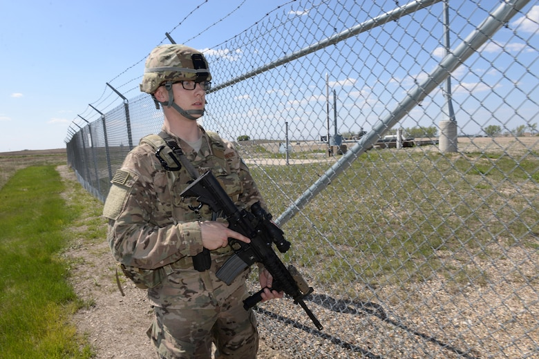 Airman 1st Class Alex Pauling, of the 219th Security Forces Squadron performs a sweep of the area for anything suspicious at a Minot Air Force Base, North Dakota, launch facility May 20, 2015. The exercise included an intermingled combination of North Dakota Air National Guard members doing their annual training and 91st Missile Security Forces Squadron members performing their day-to-day duties. The Air National Guard members are routinely integrated among the U.S. Air Force active duty personnel as they perform the real-World mission of missile field security in a seamless and indistinguishable manner. (U.S. Air National Guard photo by Senior Master Sgt. David H. Lipp/Released)