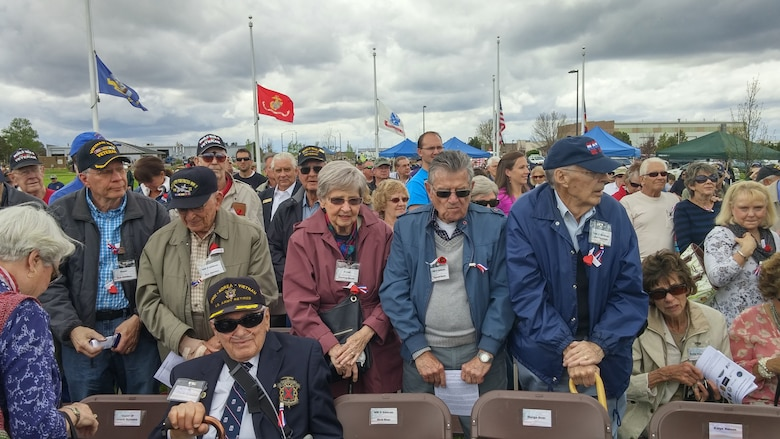 World War II veterans stand to be recognized during the Memorial Day ceremony May 23, 2015, at the Colorado Freedom Memorial in Aurora, Colorado. This year's ceremony had multiple guest speakers, flyovers, military displays and also marked the 70th anniversary of the end of World War II. (courtesy photo)