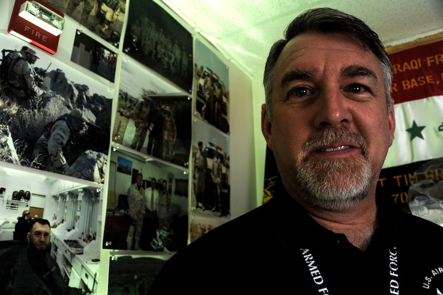 Tim Griggs, 42nd Medical Group recovery care coordinator, is surrounded by photos depicting his 27-year Air Force career, May 21, 2015, Maxwell Air Force Base, Alabama. Before becoming a recovery care coordinator, Griggs served in the Air Force for 27 years, spending 24 years working in security forces and three years as a Senior NCO Academy instructor. (U.S. Air Force photo by Airman 1st Class Alexa Culbert)