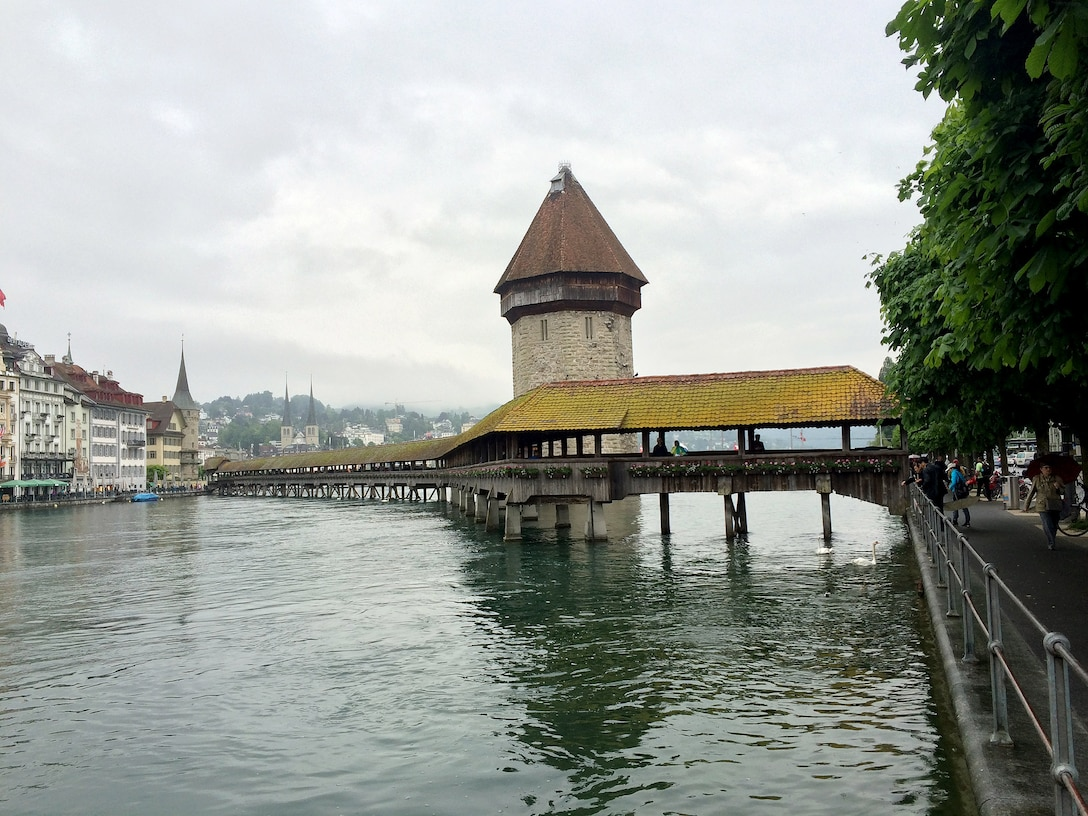 The famous covered, wooden bridge – Kapellbrücke – stretches across the Reuss River in Lucerne, Switzerland. The bridge was constructed in the 1300s to connect the two sides of the town and protect against enemy attacks. It is the oldest truss bridge in the world. (U.S. Air Force photo by Staff Sgt. R.J. Biermann/Released)