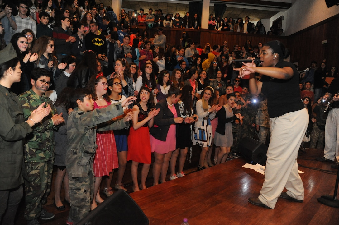 The U.S. Air Forces in Europe Band's music group, Touch n' Go performed at numerous locations across the island of Terceira as part of community outreach efforts,  April 23-26, 2015. The performances allowed the Air Force to connect with members of the community to thank them for their support over the years. This photo features Senior Airman Paula Hunt entertaining students at Praia High School. (U.S. Air Force photo by Mr. Guido Melo)