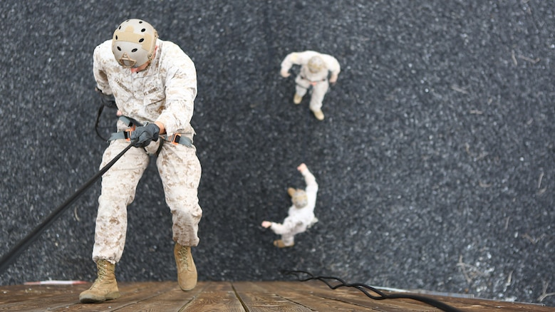 Staff Sgt. Brandon Stanbridge, a reconnaissance Marine with 1st Reconnaissance Battalion, ropes down a rappel tower in preparation for the 7th Annual Recon Challenge aboard Marine Corps Base Camp Pendleton, California, May 15, 2015. Rappelling is one of the many events that participants took part in during the 30-mile course.