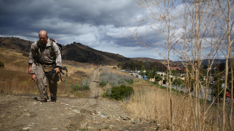 Master Sgt. Vincent Marzi, the operations chief for 1st Force Reconnaissance Company, takes his final steps as he approaches the end of the 7th Annual Recon Challenge aboard Marine Corps Base Camp Pendleton, California, May 15, 2015. After more than 12 hours of events and hiking with a pack, Marzi knew he made Maj. Jeremy Graczyk, a former platoon commander and fallen Marine, proud.