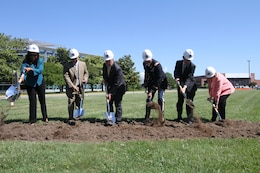 HAMPTON, Va. -- Leaders break ground for the NASA Computational Research Facility  at NASA Langley Research Center May 22, 2015.  Pictured, left to right, are Shannon Kendrick, district director for the office of U.S. Rep. Scott Rigell; Erik Weiser, acting director of center operations at NASA Langley; David Bowles, acting center director at NASA Langley; Col. Paul Olsen, commander, Norfolk District, U.S. Army Corps of Engineers; Christian Jahrling, vice president of Turner Construction Co.; and Linda Curtis, vice mayor of the City of Hampton. The 40,000-square-foot center, the construction of which will be overseen by the Norfolk District and carried out by Turner Construction Co., will provide a consolidated data center and high-density office space. (U.S. Army photo/Kerry Solan