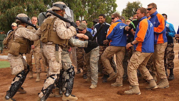 Marines with 2nd Law Enforcement Battalion demonstrate crowd control procedures against group of Moroccan, Dutch and Belgium soldiers acting as an unruly crowd May 20 in the Tifnit, Morocco, training area. Exercise African Lion 15 is an annually-scheduled, combined U.S.–Moroccan exercise designed to improve mutual understanding of each nation's tactics, techniques and procedures while demonstrating the strong bond between the two nation's militaries.  The one-week exercise includes various types of military training, including a command post exercise; stability operations, such as nonlethal weapons training and crisis/disaster response training.  Additionally, in February an intelligence capacity building seminar was conducted.