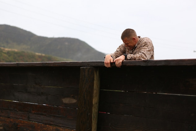 Master Sgt. David Jarvis, a reconnaissance Marine with 1st Reconnaissance Battalion, pushes over a wall during the obstacle course portion of the 7th Annual Recon Challenge aboard Marine Corps Base Camp Pendleton, Calif., May 15, 2015. Jarvis would go on to win the Recon Challenge with his partner, Capt. Patrick Zuber, a company commander for 1st Reconnaissance Battalion, with a time of 8 hours and 35 minutes.