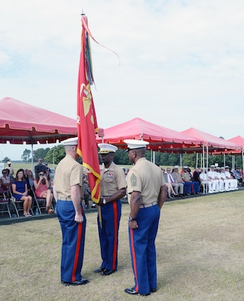 Lt. Col. James C. Carroll III, commanding officer, Marine Corps Logistics Base Albany, receives the unit colors from Col. Don Davis, outgoing commanding officer, MCLB Albany, during a change of command ceremony held May 28 on Schmid Field.
