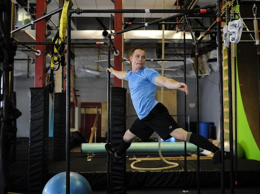 Staff Sgt. Randall Forsythe trains May 21, 2015, to compete on the TV show American Ninja Warrior. Forsythe, a 375th Civil Engineer Squadron firefighter, found out he was selected to represent the Air Force on a special military tribute episode. (U.S. Air Force photo/Staff Sgt. Stephenie Wade)