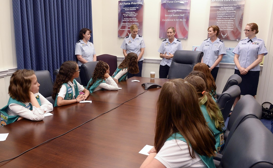 A panel of Airmen from Headquarters Air Force, consisting of Lt. Col. Heather Marshall, Col. Jennifer Short,  Lt. Col. Kim Campbell, Lt. Col. Gina Sabric and Staff Sgt. Sara Brice,  answer questions from Girl Scout Troop 4507 at the Pentagon in Washington, D.C., May 21, 2015. During the visit, the Airmen discussed stereotypes in the Air Force and how they were able to overcome them in order to achieve success. (Air Force photo/Andy Morataya)