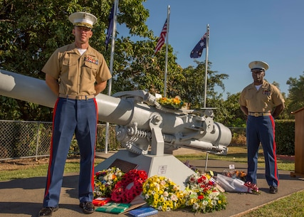 Lieutenant Colonel Eric J. Dougherty and Sgt. Maj. Marcus A. Chestnut stand at parade rest during a service commemorating the 73rd Anniversary of the Battle of the Coral Sea May 8 at USS Peary Gun Memorial, Darwin, Northern Territory, Australia. The Battle of the Coral Sea was a series of naval engagements, between the U.S. and Australia against Japan, which occurred May 4 to May 8, 1942 on the northeast coast of Australia. Community engagements between the U.S. military and Australian Defence Force reinforce relations that date back to when both countries fought alongside each other in World Wars I and II, Korea, Vietnam, Iraq and Afghanistan together. Dougherty is the commanding officer of 1st Battalion, 4th Marine Regiment, Marine Rotational Force – Darwin.  Chestnut is the sergeant major of 1st Battalion, 4th Marines, MRF-D.