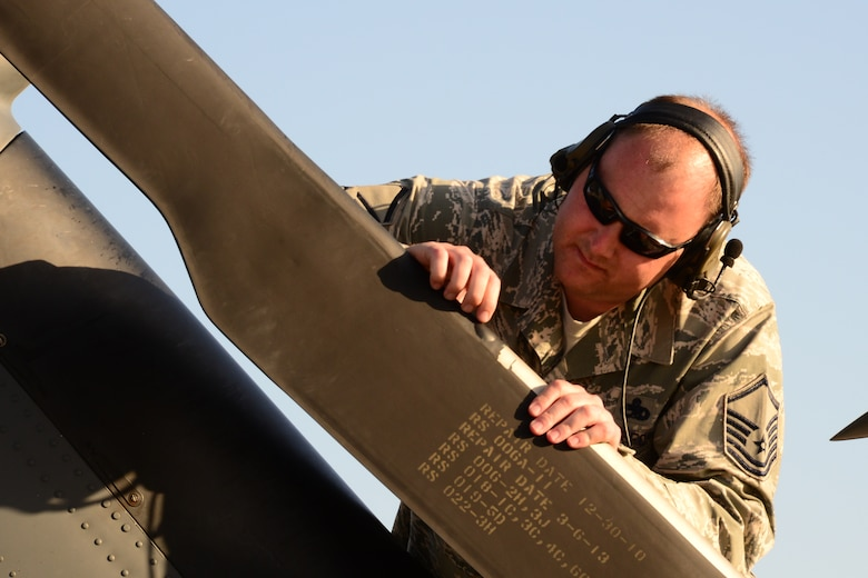 California Air National Guardsman Master Sgt. Jeremy Mayo, a production superintendent assigned with the 129th Maintenance Group, inspects a tail rotor during the multi-day deployment training at Marine Corps Base, Camp Pendleton, Calif., on March 12, 2015. (U.S. Air National Guard photo by Senior Airman Rachael Kane/Released)