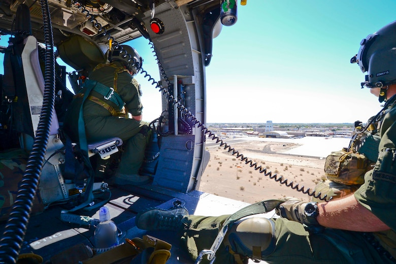 California Air National Guardsman assigned with the 129th Rescue Squadron, Moffett Federal Airfield, Calif., looks out at the desert floor at the Yuma Training Range, Calif., March 19, 2015. The guardsmen from the 129th Rescue Squadron conducted a week of electronic warfare training to improve the ability of Airmen to operate safely in a hostile environment.   (U.S. Air National Guard photo by Senior Airman Rachael Kane/Released)